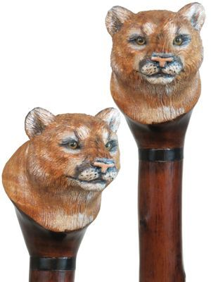 Our carved wood hiking staffs can feature bear, wolf, cougar, lion ...